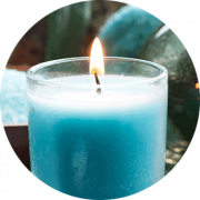 lit blue candle in glass jar