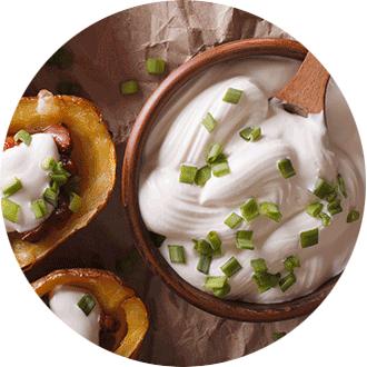 non dairy sour cream in wooden bowl