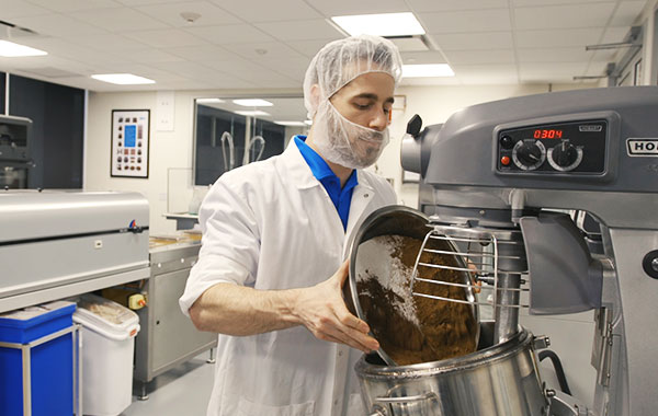 food scientist working with chocolate in lab