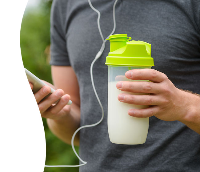 healthy man holding protein smoothie