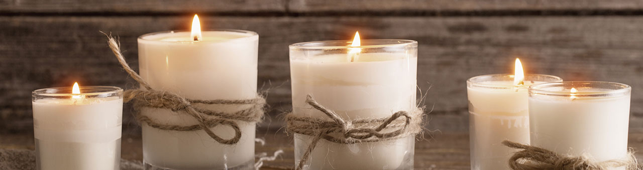 rustic white candles in jars